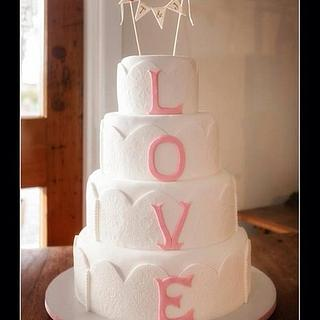 Four tiers 'LOVE' wedding cake.
