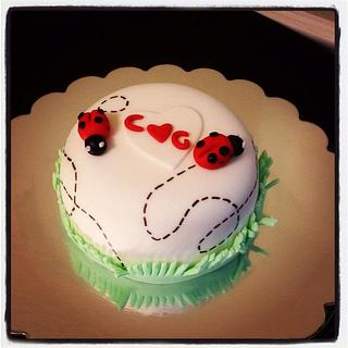 Ladybug theme anniversary cake