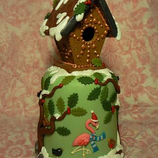 Mini Christmas cake with gingerbread birdhouse, for a bird lover.