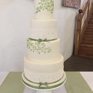 Edible lace and royal icing piped leaves and buds