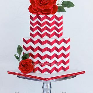 Red chevron cake with big rose