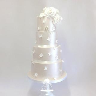 Four tier shimmering wedding cake