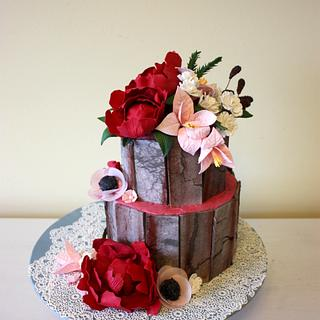 Burgundy and blush flower cake with weathered wood effect