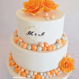 Wedding cake in white/orange/grey with roses