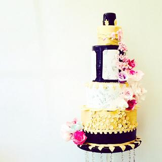 Hand painted Black and Gold floral wedding cake.
