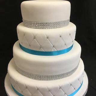 4 tier teal and diamanté wedding cake