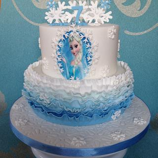 Frozen ruffle and snowflakes cake
