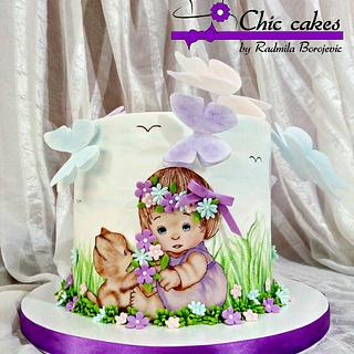 Little girl and the little cat on the cake