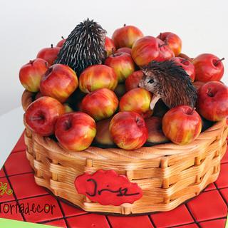 Hedgehogs in apple basket