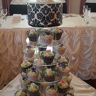 Simple wedding cake and cupcakes