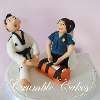 Cake topper for a paramedic bride and a karate instructor groom