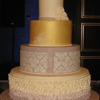 Four Tier Wedding cake in Gold with Frills