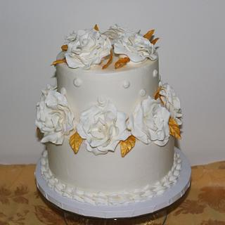 Buttercream with white modeling chocolate roses