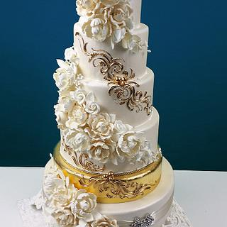 Cascading Foral Bouquets with a Golden Tier Wedding Cake