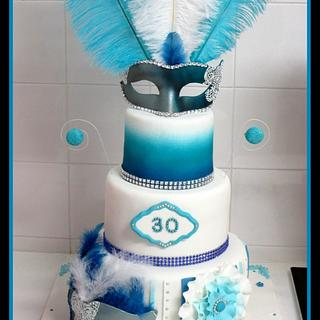 White, blue and silver venetian masked ball cake