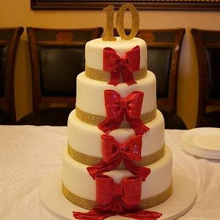 Anniversary Cake adourned with Large Red Bows - Cake by Jewell Coleman