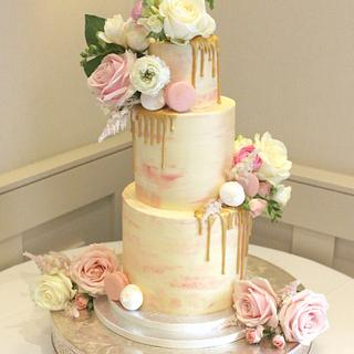 Watercolour effect buttercream cake with gold drip effect and fresh flowers