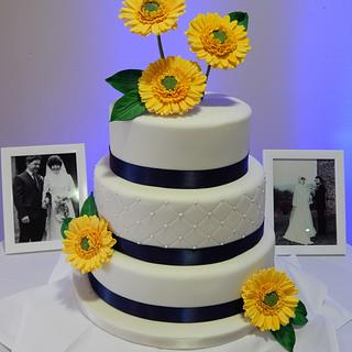 Gerbera and Navy wedding cake.