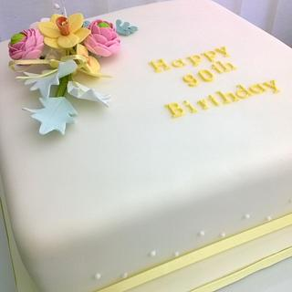 Traditional 90th cake with spring flower spray
