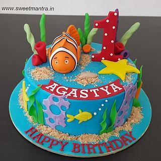 Nemo theme customized cake with corals, starfish for 1st birthday