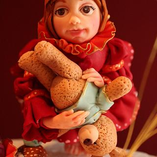 Fondant figure of the little girl and the harlequin