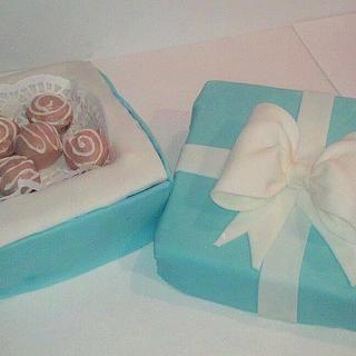 box cake with some cake pops on it