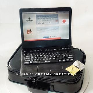 Laptop and bag - Cake by Urvi Zaveri