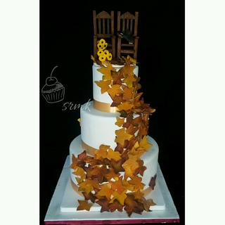 autumn theme wedding cake with rocking chair topper