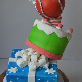 Topsy turvy Xmas theme cake  - Cake by onceuponacake3