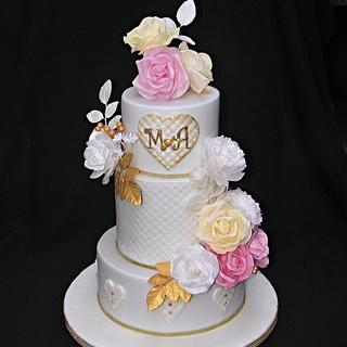 Wedding cake with flowers of edible paper