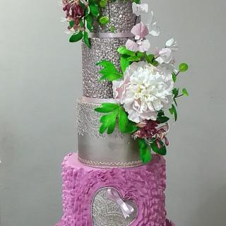 Wedding cake with peonies, bougenvialea and honeysuckle.