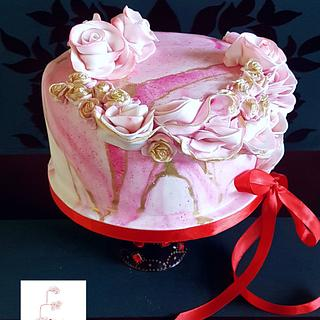 Pink marbled and roses birthday cake