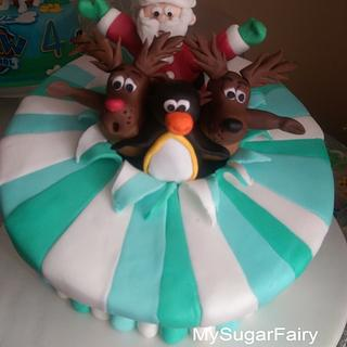 Santa & Co Exploding from a cake.