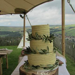 Rustic buttercream and olive branches wedding cake