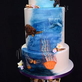 Ocean themed cake. Free hand painting.