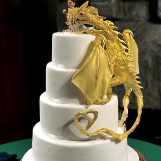 Gold Dragon climbing up a wedding cake to be fed by a lovely maiden!