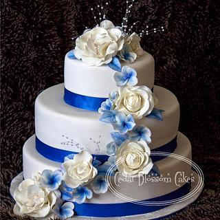 Blue and white roses and frangipanni cake