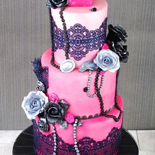 Pink ombre sugar skull themed cake
