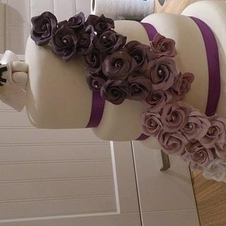 four tiered wedding cake with purple roses and bride and groom handmade topper (with karate theme) x