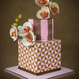 Romantic brown and pink birthday cake with geometric pattern