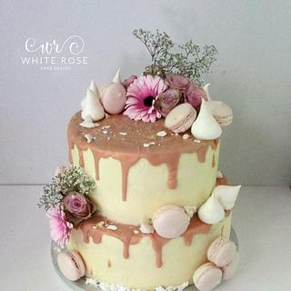 Blush Pink and Nude two tier drippy cake with fresh flowers