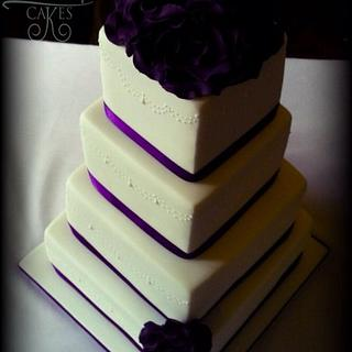 Ivory and purple roses and 4 tiers