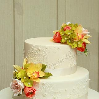 Exotic orchids and coral wedding cake