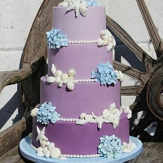 Shells and Blue hydrangeas Purple Ombre wedding cake