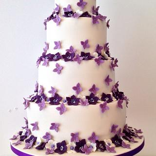 Purple flowered wedding cake