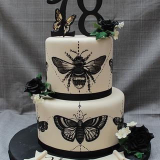 Moth tattoo cake