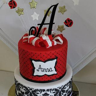 Red, black and white birthday cake