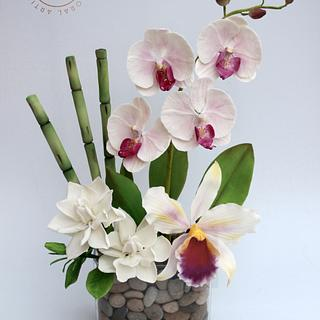 Bouquet of flowers in sugar. Phalaenopsis orchid, Cattleya orchid, Gardenias and Bamboo