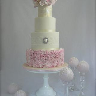 Four Tier Ruffle Wedding cake with 10 pretty cakes balls - decorated in royal icing to match the cak