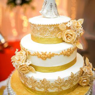 Cream and gold wedding cake